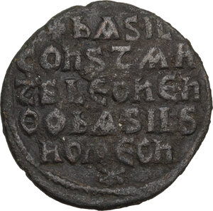 reverse: Basil I the Macedonian, with Constantine and Leo VI (867-886).. AE Follis. Constantinople mint, 870-879