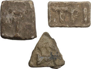 obverse: Lot of 3 weights with inscriptions.  Roman period.  38 x 33 mm, 40 x 25 mm,  35 x 35 x 35 mm