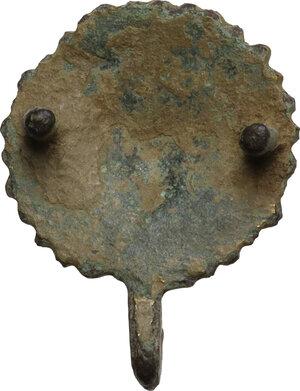 reverse: Gilt bronze applique with face.  Roman period, 2nd - 4th century AD.  Diameter: 22 mm