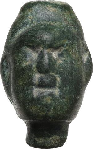 obverse: Bronze head.  Roman period, 1st-3rd century AD.  17 x 11 mm