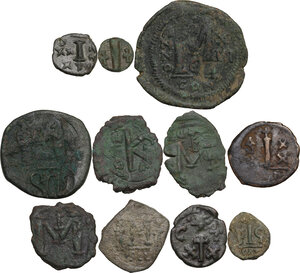 reverse: The Byzantine Empire.. Multiple lot of eleven (11) unclassified AE coins